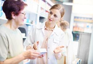 elder woman asking advise fromn the pharmacist