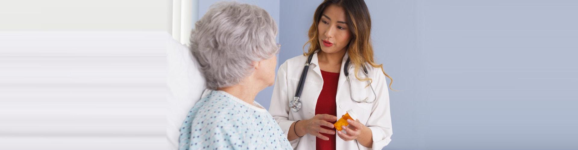 pharmacist showing elder woman medicinal options